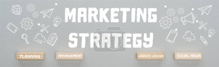 panoramic shot of marketing strategy inscription near wooden blocks with planning, management, website design, social media words and multimedia icons illustration on grey background, business concept