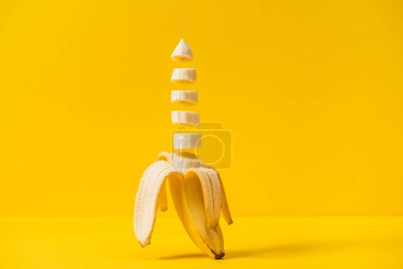 Photo for Sliced tropic sweet delicious banana isolated on yellow - Royalty Free Image
