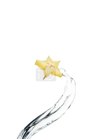 Photo for Exotic star fruit slice and flowing water isolated on white - Royalty Free Image
