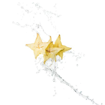 fresh exotic star fruit slices and water splash with drops isolated on white