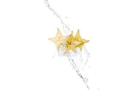 fresh tropical star fruit slices and water splash with drops isolated on white