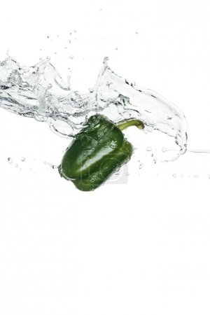 green whole bell pepper with clear water splash isolated on white