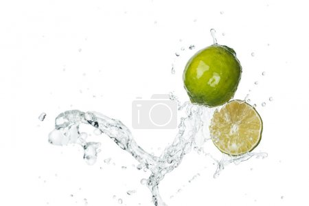 Photo for Green fresh limes with clear water splash and drops isolated on white - Royalty Free Image