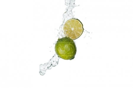 Photo for Green limes with clear water splash and drops isolated on white - Royalty Free Image