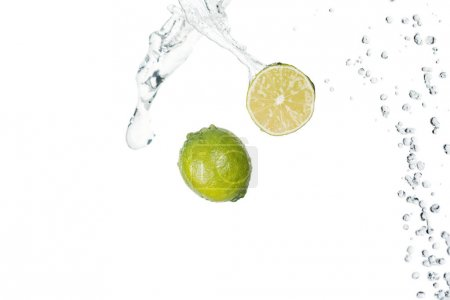 Photo for Green fresh limes with clear water splash isolated on white - Royalty Free Image