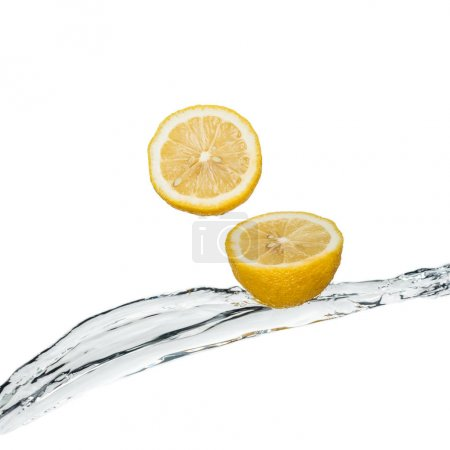 Photo for Yellow fresh lemons with clear water stream isolated on white - Royalty Free Image