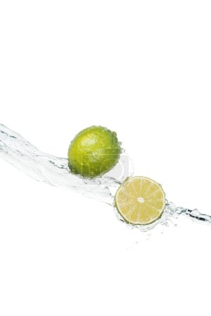 Photo for Green fresh limes with clear water stream isolated on white with copy space - Royalty Free Image