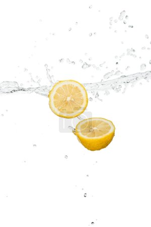 Photo for Yellow lemon halves with clear water splash and drops isolated on white - Royalty Free Image