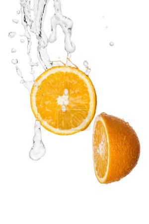 fresh orange halves with clear water splash isolated on white