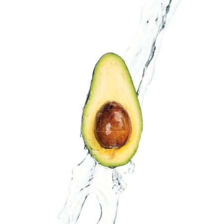 Photo for Ripe nutritious avocado half with seed and transparent water stream isolated on white - Royalty Free Image