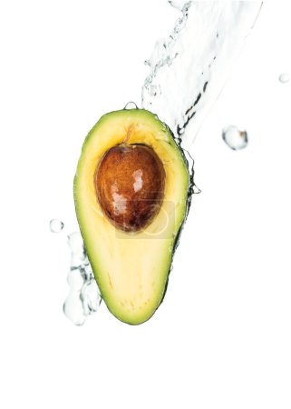 Photo for Nutritious avocado half with seed and transparent water splash with drops isolated on white - Royalty Free Image