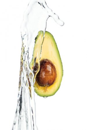 Photo for Ripe nutritious avocado with seed and transparent water stream isolated on white - Royalty Free Image