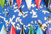 "Постер, картина, фотообои ""Colorful party hats and silver confetti on blue background"""