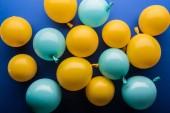 "Постер, картина, фотообои ""Top view of yellow and blue balloons festive background"""