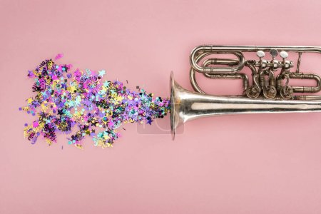 Photo for Colorful confetti with trumpet on pink background - Royalty Free Image