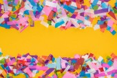 "Постер, картина, фотообои ""Top view of multicolored confetti frame on yellow background """