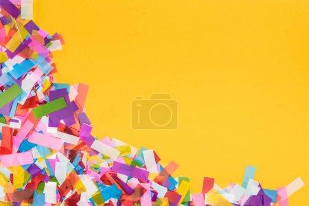 Foto de Colorful confetti frame on yellow background - Imagen libre de derechos