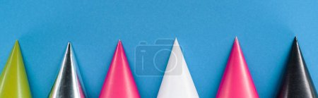 Photo for Panoramic shot of party hats on blue party background - Royalty Free Image