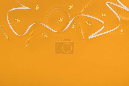 Foto de Top view of birthday decoration on orange background - Imagen libre de derechos