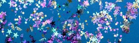 Foto de Panoramic shot of colorful confetti on blue party background - Imagen libre de derechos