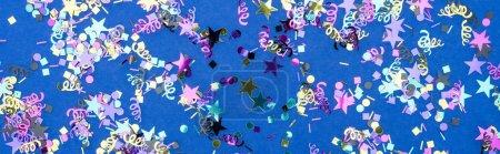 Foto de Panoramic shot of colorful confetti on blue festive background - Imagen libre de derechos