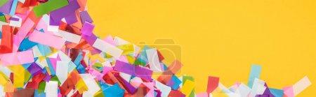 Foto de Panoramic shot of colorful confetti frame on yellow background - Imagen libre de derechos