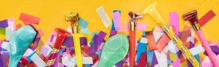 Photo pour Panoramic shot of party decoration on yellow festive background - image libre de droit