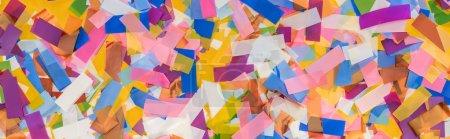 Foto de Panoramic shot of multicolored confetti festive background - Imagen libre de derechos
