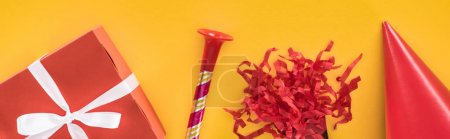 Photo for Panoramic shot of red party decoration on yellow festive background - Royalty Free Image