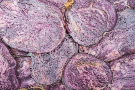 Photo for Top view of cut fresh purple radish slices in stack - Royalty Free Image
