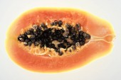 "Постер, картина, фотообои ""top view of ripe exotic papaya half with black seeds isolated on white"""