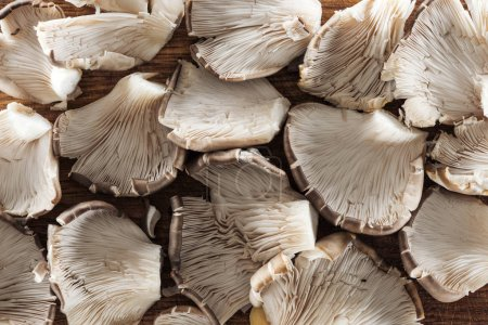 Photo for Top view of white raw textured mushrooms in pile - Royalty Free Image