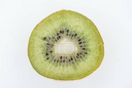 Foto de Close up view of cut fresh nutritious green kiwi with seeds isolated on white - Imagen libre de derechos