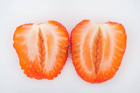 Photo for Close up view of fresh ripe red strawberry halves on white background - Royalty Free Image