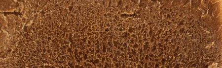 Photo for Panoramic shot of brown fresh textured bread - Royalty Free Image