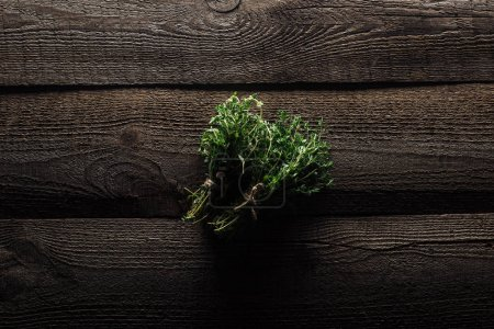 Photo for Top view of green thyme on wooden brown rustic table - Royalty Free Image