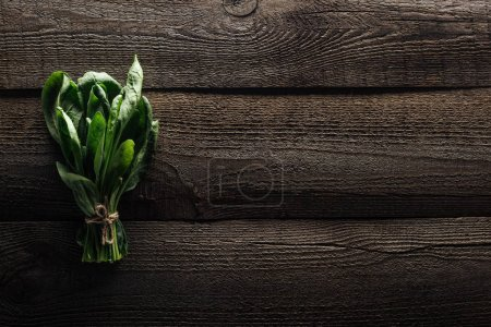 Photo for Top view of green spinach leaves on wooden rustic table - Royalty Free Image