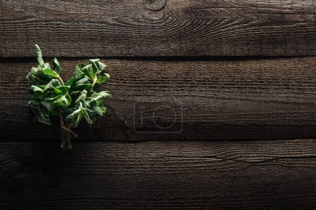 Photo for Top view of green fresh mint on wooden rustic table - Royalty Free Image