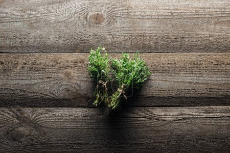 Photo for Top view of green thyme on wooden weathered table - Royalty Free Image