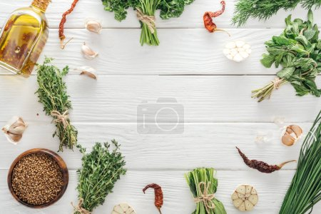 Photo for Top view of green herbs and spices on white wooden table with copy space - Royalty Free Image