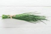 "Постер, картина, фотообои ""top view of fresh green onion on white wooden table"""