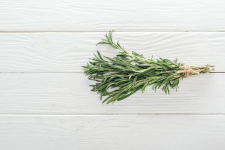 Photo for Top view of fresh green rosemary on white wooden table - Royalty Free Image