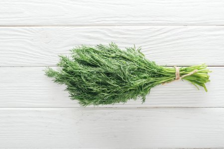 Photo for Top view of fresh green dill on white wooden table - Royalty Free Image