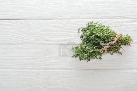 Photo for Top view of fresh green thyme on white wooden table - Royalty Free Image