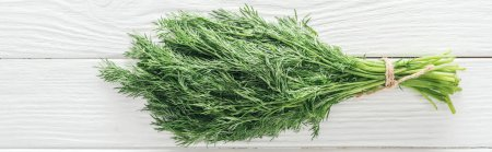 Photo for Top view of fresh green dill on white wooden table, panoramic shot - Royalty Free Image