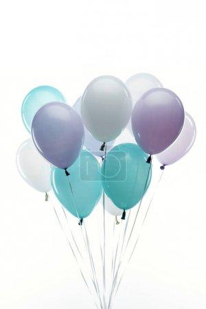 Foto de Festive decorative blue, purple and white balloons isolated on white - Imagen libre de derechos