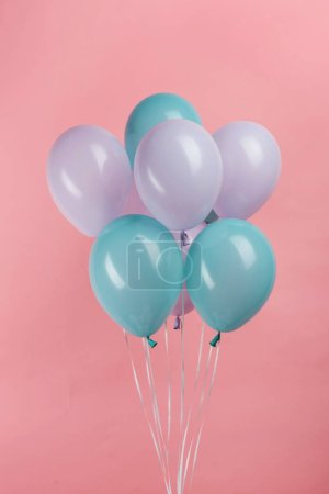 Photo for Blue and purple festive balloons on pink background - Royalty Free Image