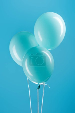 Photo for Minimalistic blue decorative balloons on blue background - Royalty Free Image