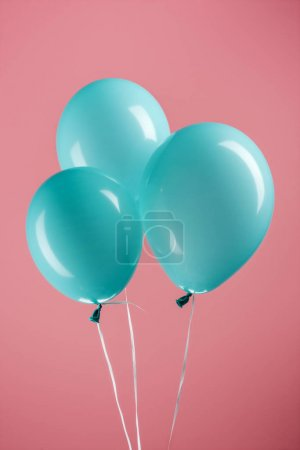 Photo for Bright blue decorative festive balloons on pink background - Royalty Free Image