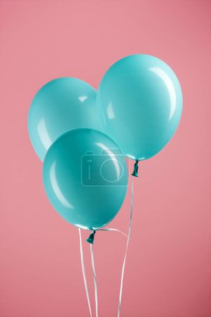 Photo for Blue decorative festive balloons on pink background - Royalty Free Image